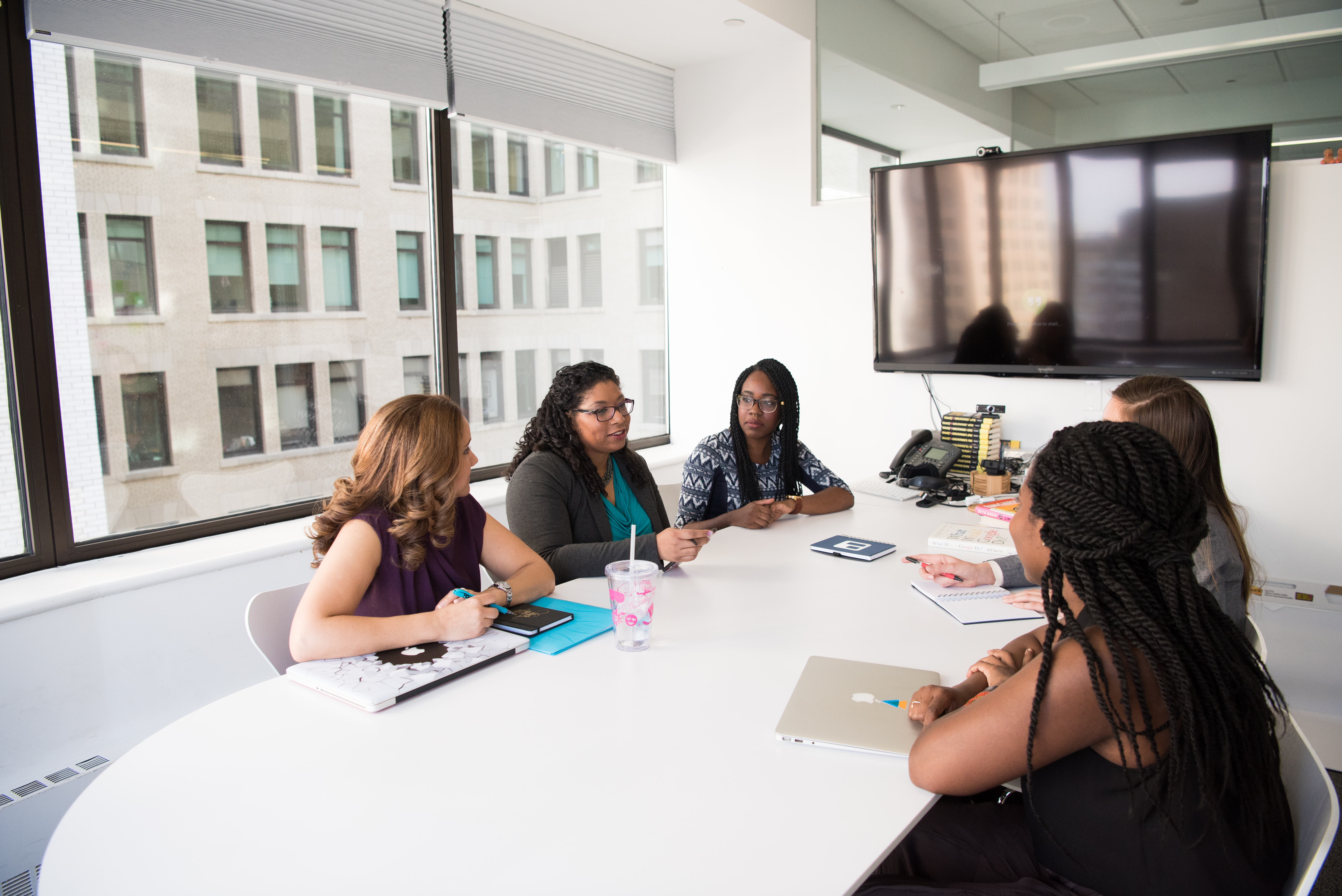 Canva - Group of Five Women Gathering Inside Office-1
